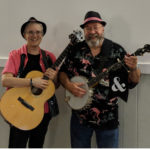 Two musicians, guitar, banjo