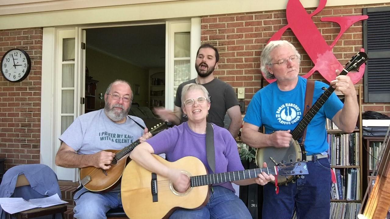 four band members, guitar, mandolin, banjo